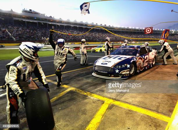 Brad Keselowski driver of the Miller Lite Ford pits during the NASCAR Sprint Cup Series CocaCola 600 at Charlotte Motor Speedway on May 25 2014 in...