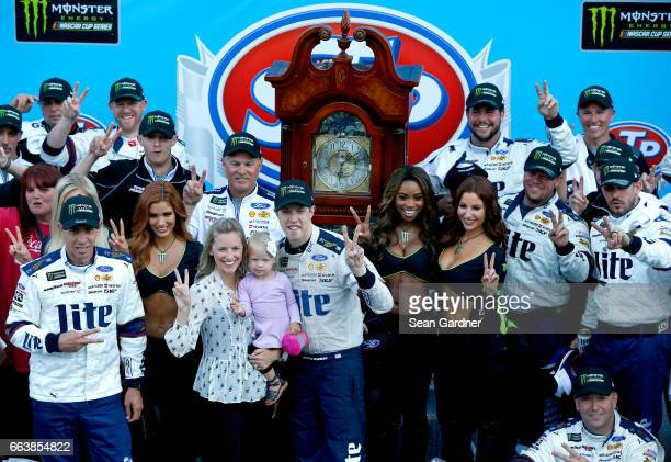 Brad Keselowski driver of the Miller Lite Ford poses for a photo in Victory lane with his wife Paige and daughter Scarlett during the Monster Energy...