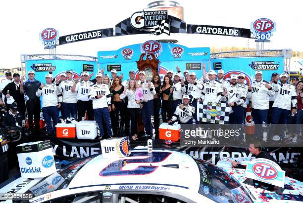 Brad Keselowski driver of the Miller Lite Ford poses in Victory lane with his wife Paige and daughter Scarlett during the Monster Energy NASCAR Cup...