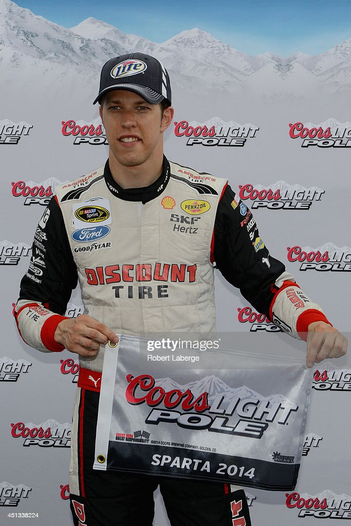 <a gi-track='captionPersonalityLinkClicked' href=/galleries/search?phrase=Brad+Keselowski&family=editorial&specificpeople=890258 ng-click='$event.stopPropagation()'>Brad Keselowski</a>, driver of the #2 Miller Lite Ford, poses with the Coors Light Pole Award after qualifying for the pole for the NASCAR Sprint Cup Series Quaker State 400 presented by Advance Auto Parts at Kentucky Speedway on June 27, 2014 in Sparta, Kentucky.