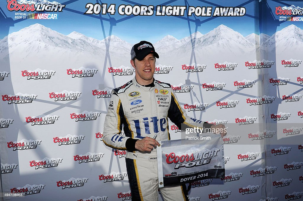 Brad Keselowski, driver of the #2 Miller Lite Ford, poses with the Coors Light Pole Award after qualifying for the pole for the NASCAR Sprint Cup Series FedEx 400 Benefiting Autism Speaks at Dover International Speedway on May 30, 2014 in Dover, Delaware.