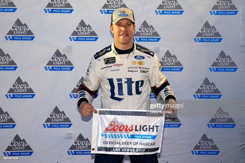 Brad Keselowski, driver of the #2 Miller Lite Ford, poses with the Coors Light Pole Award after qualifying in the pole position for the Monster Energy NASCAR Cup Series Kobalt 400 at Las Vegas Motor Speedway on March 10, 2017 in Las Vegas, Nevada.