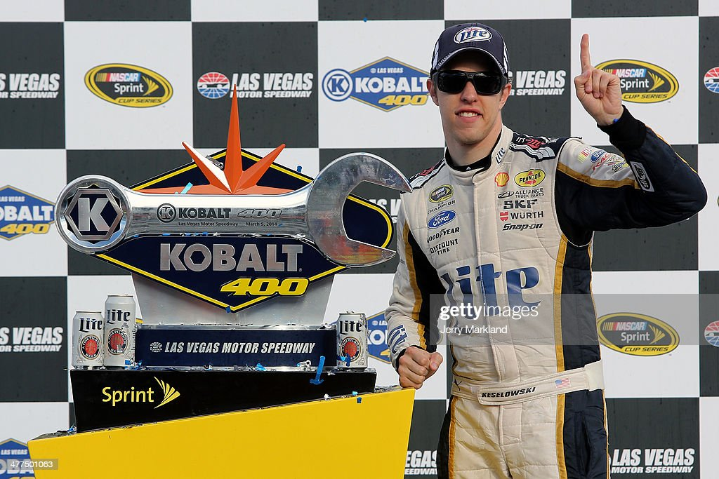 <a gi-track='captionPersonalityLinkClicked' href=/galleries/search?phrase=Brad+Keselowski&family=editorial&specificpeople=890258 ng-click='$event.stopPropagation()'>Brad Keselowski</a>, driver of the #2 Miller Lite Ford, poses with the trophy after winning the NASCAR Sprint Cup Series Kobalt 400 at Las Vegas Motor Speedway on March 9, 2014 in Las Vegas, Nevada.