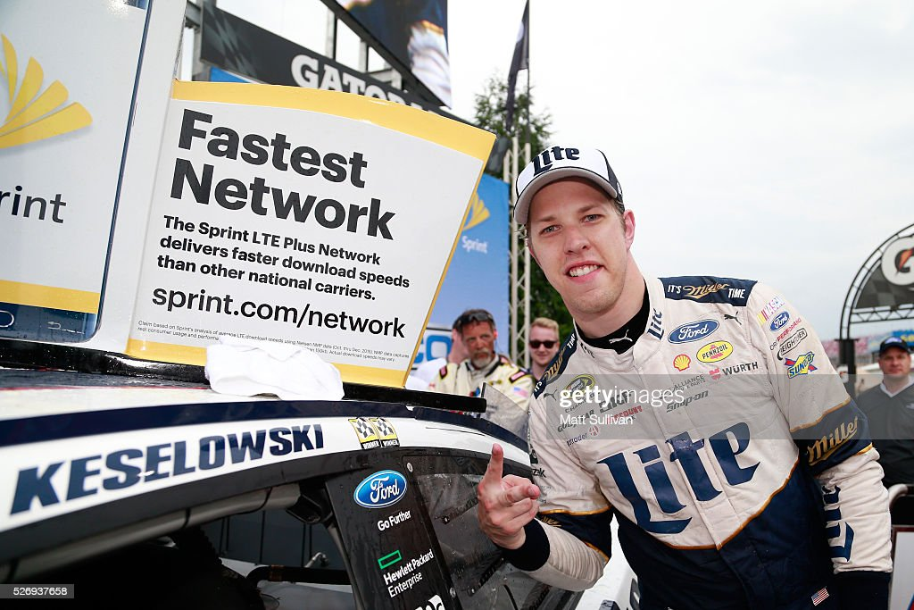 Brad Keselowski, driver of the #2 Miller Lite Ford, poses with the winner's decal in Victory Lane after winning the NASCAR Sprint Cup Series GEICO 500 at Talladega Superspeedway on May 1, 2016 in Talladega, Alabama.