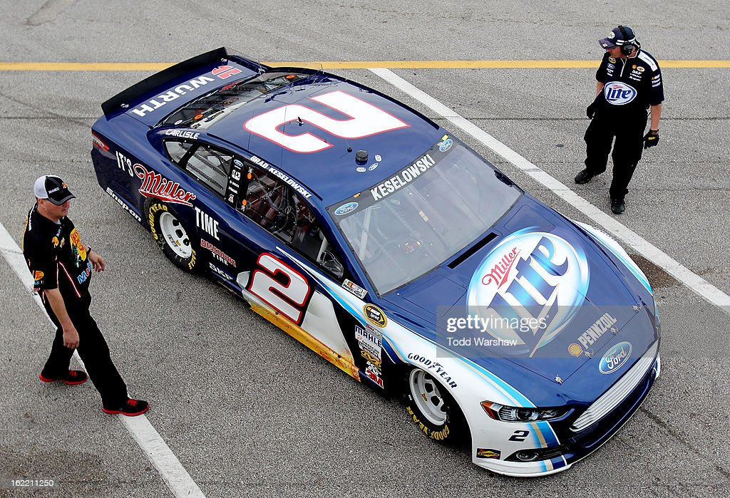 <a gi-track='captionPersonalityLinkClicked' href=/galleries/search?phrase=Brad+Keselowski&family=editorial&specificpeople=890258 ng-click='$event.stopPropagation()'>Brad Keselowski</a>, driver of the #2 Miller Lite Ford, pulls into the garage area during practice for the NASCAR Sprint Cup Series Daytona 500 at Daytona International Speedway on February 20, 2013 in Daytona Beach, Florida.