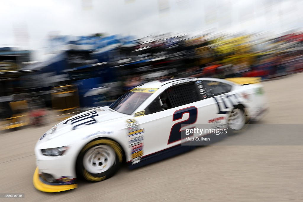 Brad Keselowski driver of the Miller Lite Ford pulls out of the garage during practice for the NASCAR Sprint Cup Series myAFibRiskcom 400 at...