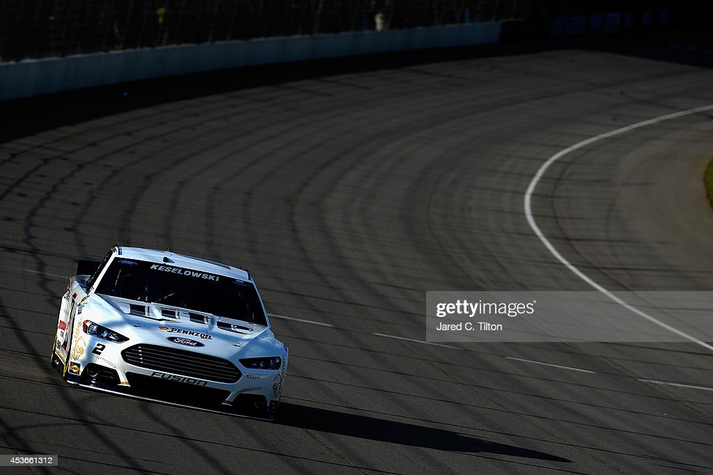 Brad Keselowski, driver of the #2 Miller Lite Ford, qualifies for the NASCAR Sprint Cup Series Pure Michigan 400 at Michigan International Speedway on August 15, 2014 in Brooklyn, Michigan.