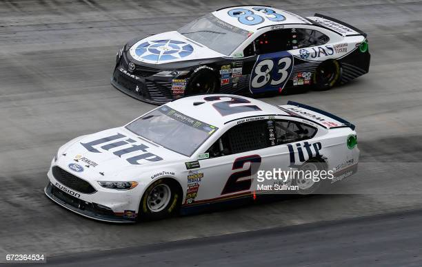 Brad Keselowski driver of the Miller Lite Ford races Corey LaJoie driver of the JAS Expedited Trucking Toyota during the Monster Energy NASCAR Cup...
