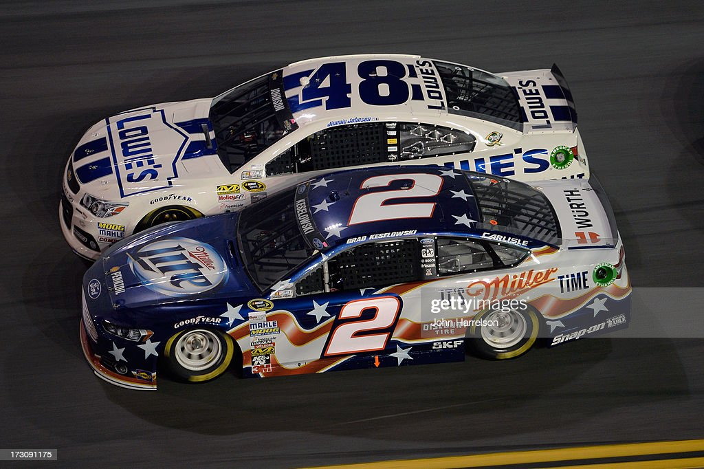 Brad Keselowski, driver of the #2 Miller Lite Ford, races Jimmie Johnson, driver of the #48 Lowe's Dover White Chevrolet, during the NASCAR Sprint Cup Series Coke Zero 400 at Daytona International Speedway on July 6, 2013 in Daytona Beach, Florida.