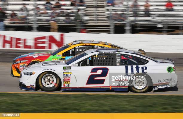 Brad Keselowski driver of the Miller Lite Ford races Kyle Busch driver of the MM's Toyota during the Monster Energy NASCAR Cup Series STP 500 at...