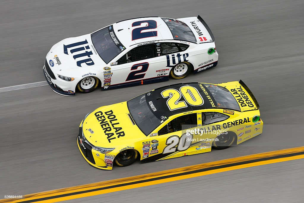 Brad Keselowski, driver of the #2 Miller Lite Ford, races Matt Kenseth, driver of the #20 Dollar General Toyota, during the NASCAR Sprint Cup Series GEICO 500 at Talladega Superspeedway on May 1, 2016 in Talladega, Alabama.