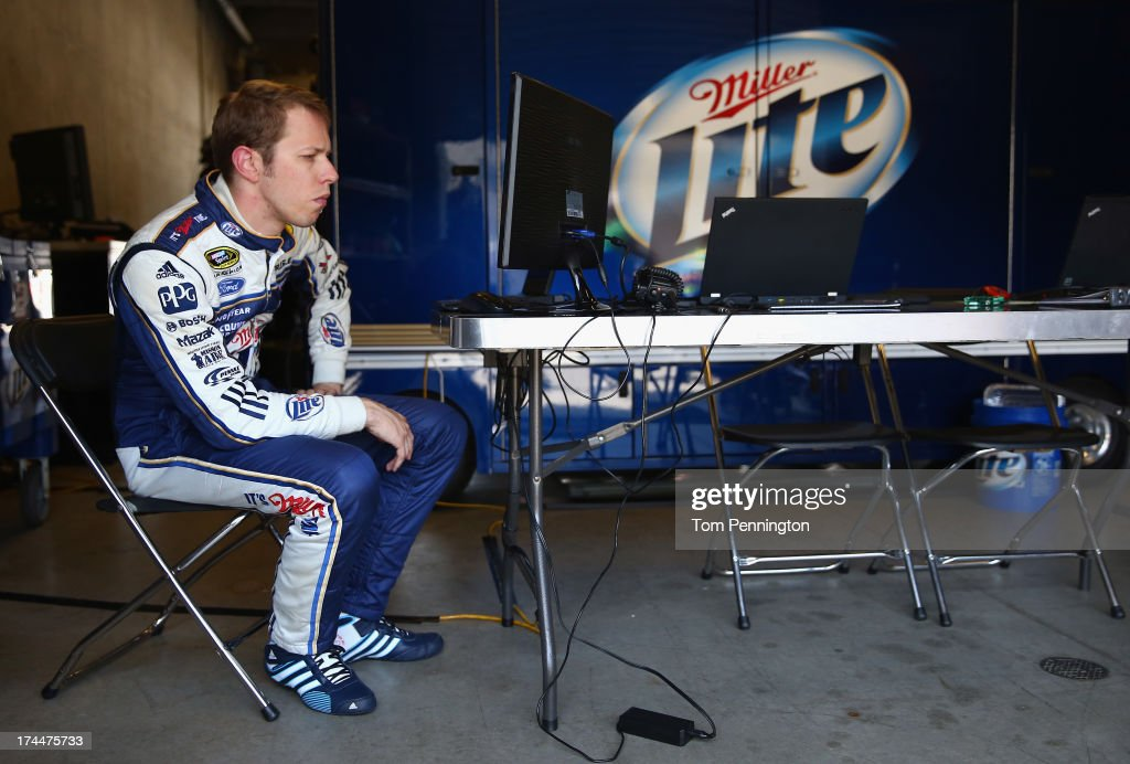 <a gi-track='captionPersonalityLinkClicked' href=/galleries/search?phrase=Brad+Keselowski&family=editorial&specificpeople=890258 ng-click='$event.stopPropagation()'>Brad Keselowski</a>, driver of the #2 Miller Lite Ford, sits in the garage area during practice for the NASCAR Sprint Cup Series Samuel Deeds 400 At The Brickyard at Indianapolis Motor Speedway on July 26, 2013 in Indianapolis, Indiana.