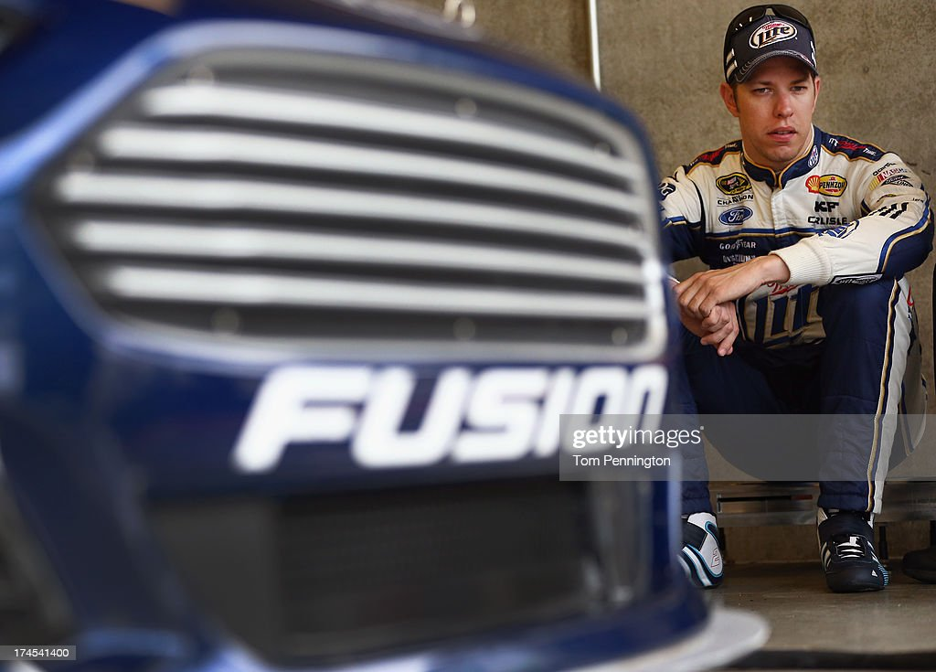 Brad Keselowski, driver of the #2 Miller Lite Ford, sits in the garage area during practice for the NASCAR Sprint Cup Series Samuel Deeds 400 At The Brickyard at Indianapolis Motor Speedway on July 27, 2013 in Indianapolis, Indiana.