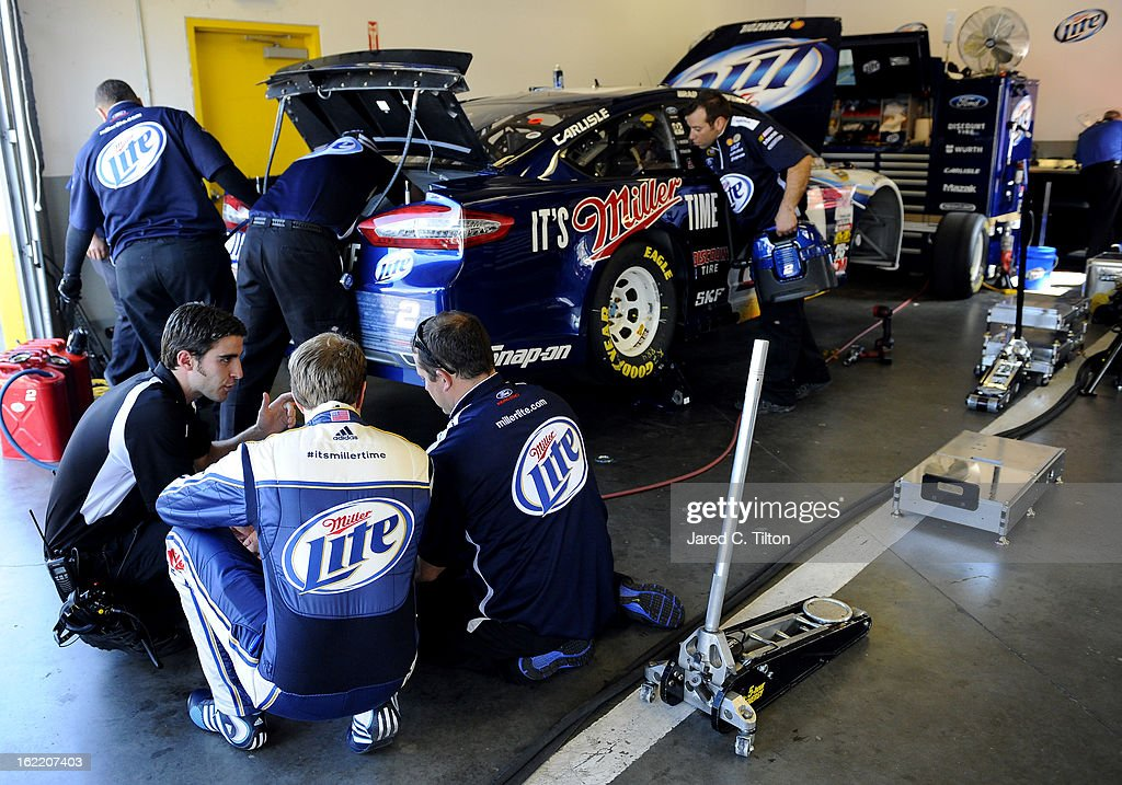 Brad Keselowski, driver of the #2 Miller Lite Ford, speaks to crew members in the garage area during practice for the NASCAR Sprint Cup Series Daytona 500 at Daytona International Speedway on February 20, 2013 in Daytona Beach, Florida.