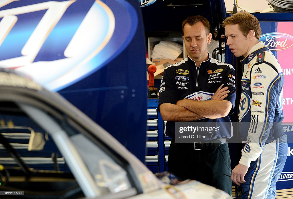 Brad Keselowski, driver of the #2 Miller Lite Ford, speaks with crew chief Paul Wolfe during practice for the NASCAR Sprint Cup Series Daytona 500 at Daytona International Speedway on February 20, 2013 in Daytona Beach, Florida.