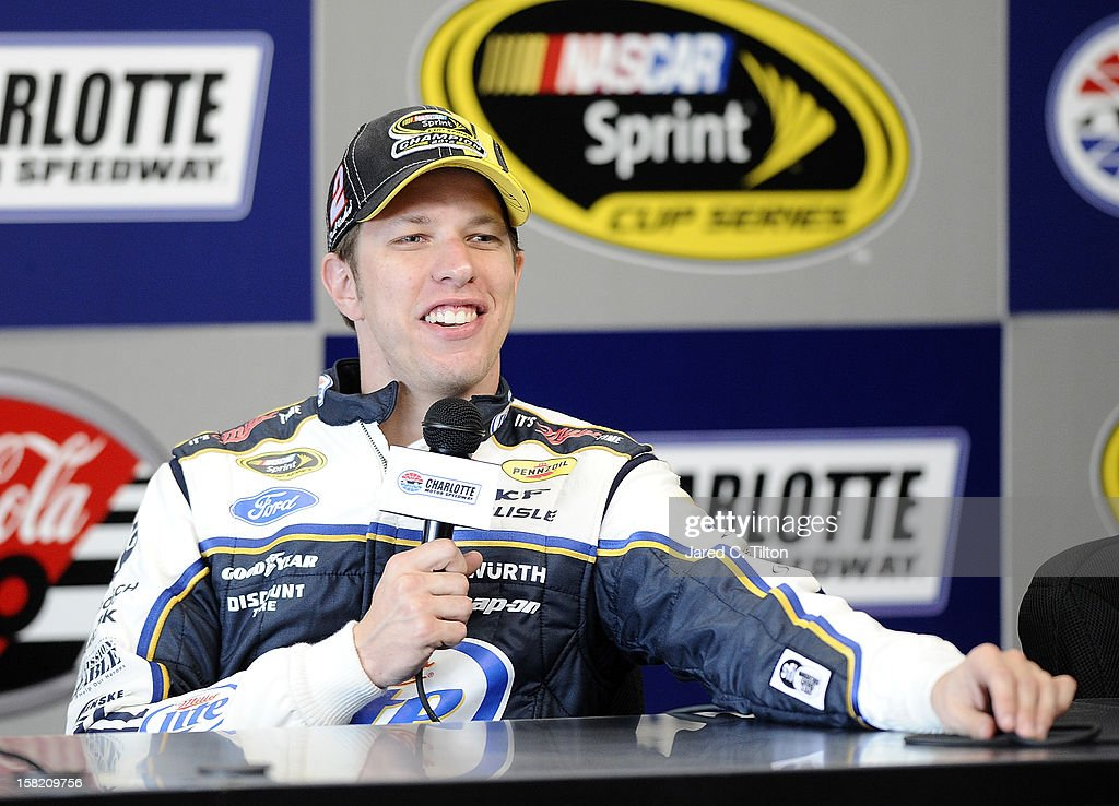 Brad Keselowski, driver of the #2 Miller Lite Ford, speaks with the media during testing at Charlotte Motor Speedway on December 11, 2012 in Concord, North Carolina.