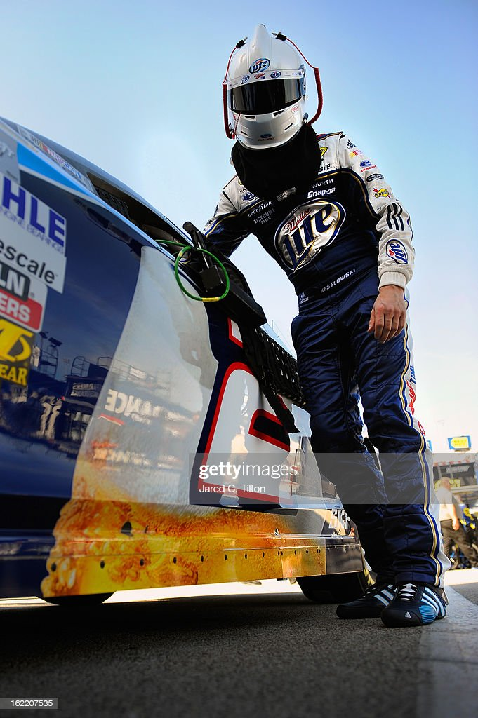 Brad Keselowski, driver of the #2 Miller Lite Ford, stands in the garage area during practice for the NASCAR Sprint Cup Series Daytona 500 at Daytona International Speedway on February 20, 2013 in Daytona Beach, Florida.