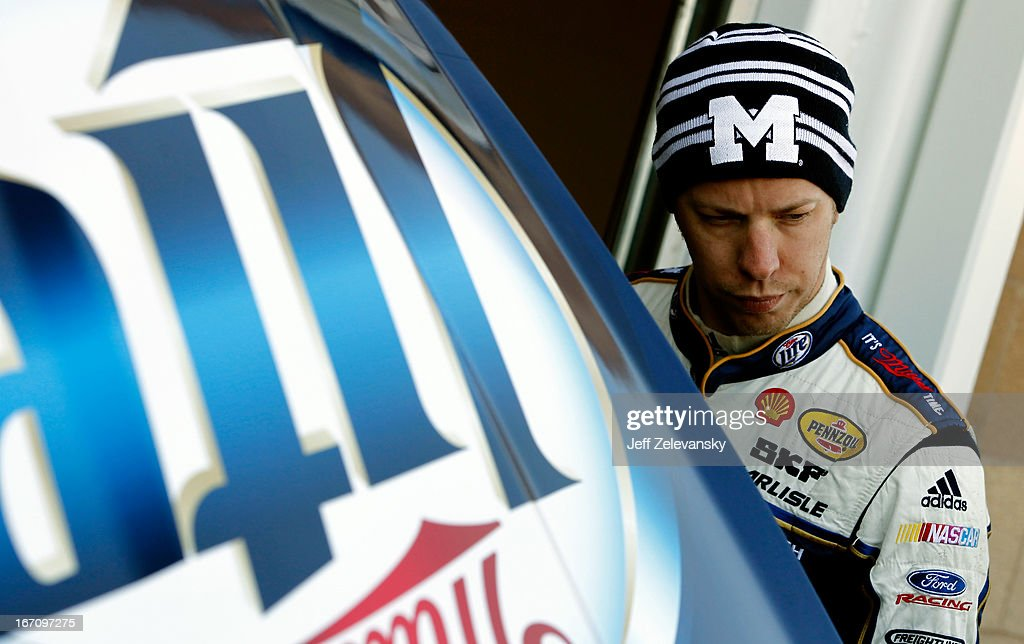 <a gi-track='captionPersonalityLinkClicked' href=/galleries/search?phrase=Brad+Keselowski&family=editorial&specificpeople=890258 ng-click='$event.stopPropagation()'>Brad Keselowski</a>, driver of the #2 Miller Lite Ford, stands in the garage area during practice for the NASCAR Sprint Cup Series STP 400 at Kansas Speedway on April 20, 2013 in Kansas City, Kansas.