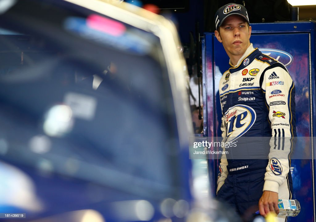 <a gi-track='captionPersonalityLinkClicked' href=/galleries/search?phrase=Brad+Keselowski&family=editorial&specificpeople=890258 ng-click='$event.stopPropagation()'>Brad Keselowski</a>, driver of the #2 Miller Lite Ford, stands in the garage during practice for the NASCAR Sprint Cup Series Sylvania 300 at New Hampshire Motor Speedway on September 21, 2013 in Loudon, New Hampshire.