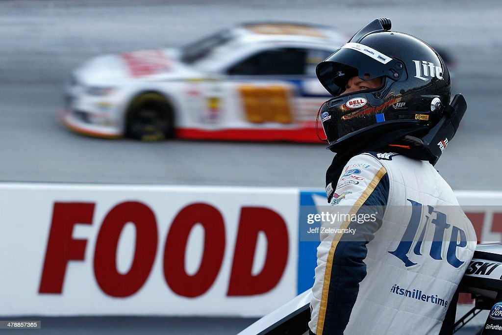 <a gi-track='captionPersonalityLinkClicked' href=/galleries/search?phrase=Brad+Keselowski&family=editorial&specificpeople=890258 ng-click='$event.stopPropagation()'>Brad Keselowski</a>, driver of the #2 Miller Lite Ford, stands in the garage area during practice for the NASCAR Sprint Cup Series Food City 500 at Bristol Motor Speedway on March 15, 2014 in Bristol, Tennessee.