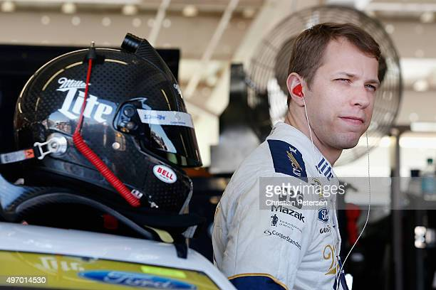 Brad Keselowski driver of the Miller Lite Ford stands in the garage area during practice for the NASCAR Sprint Cup Series Quicken Loans Race for...
