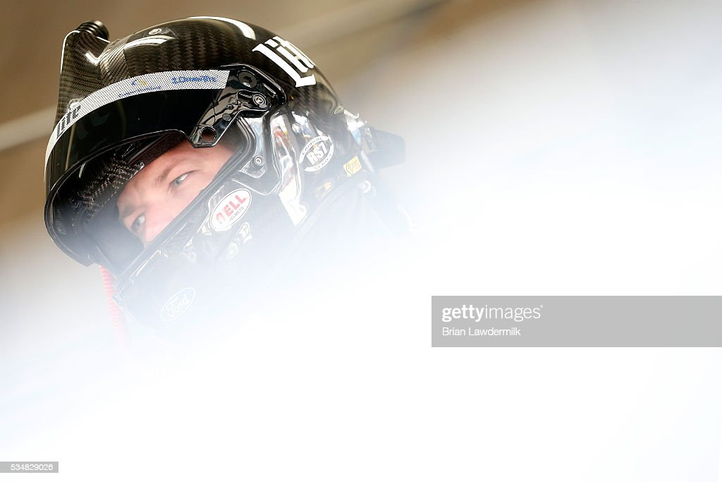 <a gi-track='captionPersonalityLinkClicked' href=/galleries/search?phrase=Brad+Keselowski&family=editorial&specificpeople=890258 ng-click='$event.stopPropagation()'>Brad Keselowski</a>, driver of the #2 Miller Lite Ford, stands in the garage area during practice for the NASCAR Sprint Cup Series Coca-Cola 600 at Charlotte Motor Speedway on May 28, 2016 in Charlotte, North Carolina.