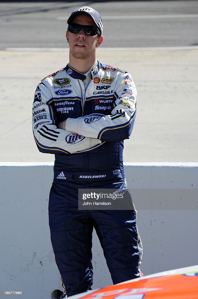 <a gi-track='captionPersonalityLinkClicked' href=/galleries/search?phrase=Brad+Keselowski&family=editorial&specificpeople=890258 ng-click='$event.stopPropagation()'>Brad Keselowski</a>, driver of the #2 Miller Lite Ford, stands on the grid during qualifying for the NASCAR Sprint Cup Series STP Gas Booster 500 on April 5, 2013 at Martinsville Speedway in Ridgeway, Virginia.