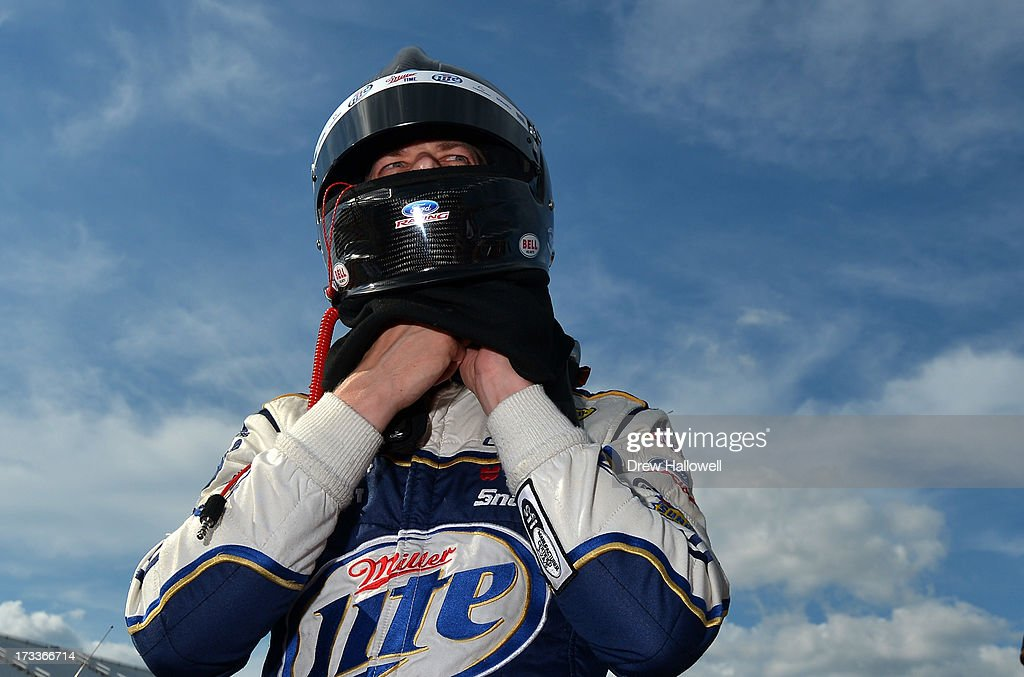 <a gi-track='captionPersonalityLinkClicked' href=/galleries/search?phrase=Brad+Keselowski&family=editorial&specificpeople=890258 ng-click='$event.stopPropagation()'>Brad Keselowski</a>, driver of the #2 Miller Lite Ford, stands on the grid after qualifying for the NASCAR Sprint Cup Series Camping World RV Sales 301 at New Hampshire Motor Speedway on July 12, 2013 in Loudon, New Hampshire.