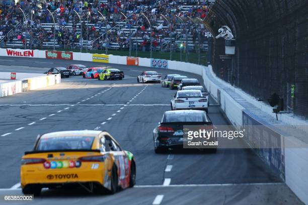 Brad Keselowski driver of the Miller Lite Ford takes the checkered flag during the Monster Energy NASCAR Cup Series STP 500 at Martinsville Speedway...