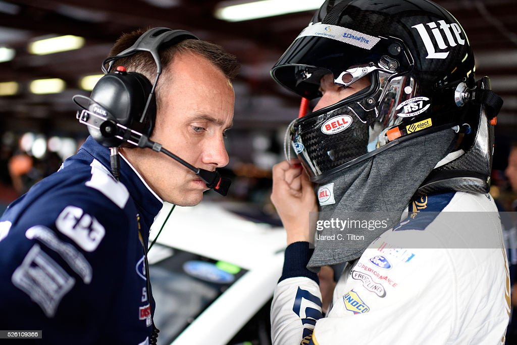<a gi-track='captionPersonalityLinkClicked' href=/galleries/search?phrase=Brad+Keselowski&family=editorial&specificpeople=890258 ng-click='$event.stopPropagation()'>Brad Keselowski</a>, driver of the #2 Miller Lite Ford, talks to crew chief <a gi-track='captionPersonalityLinkClicked' href=/galleries/search?phrase=Paul+Wolfe&family=editorial&specificpeople=2257776 ng-click='$event.stopPropagation()'>Paul Wolfe</a> in the garage area during practice for the NASCAR Sprint Cup Series GEICO 500 at Talladega Superspeedway on April 29, 2016 in Talladega, Alabama.