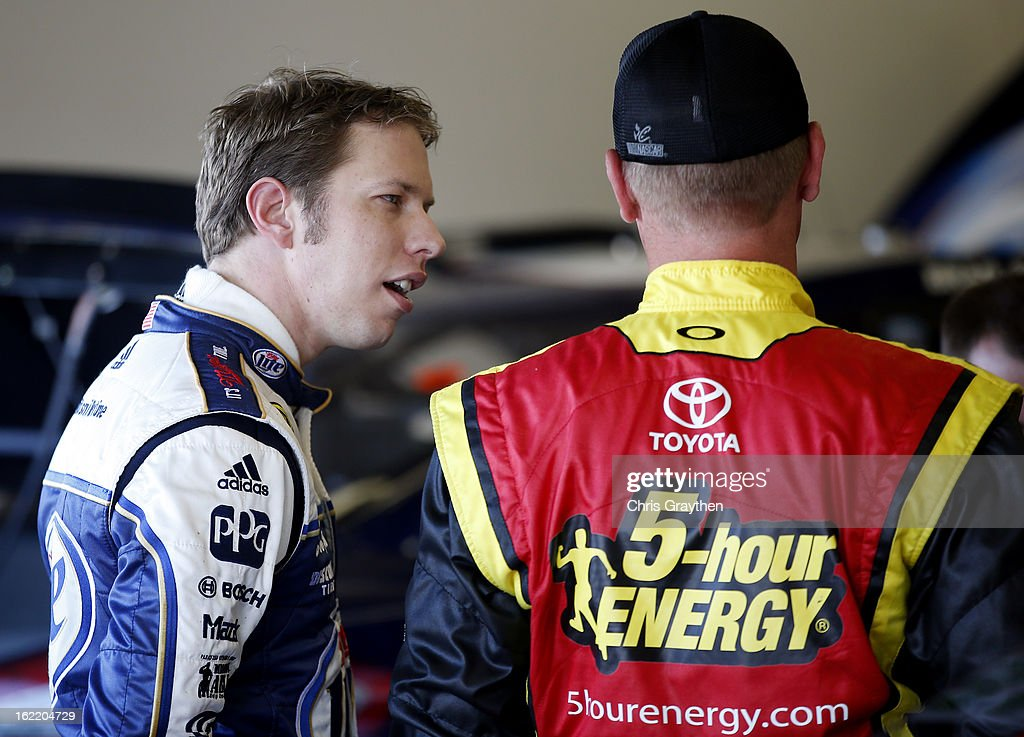 Brad Keselowski (L), driver of the #2 Miller Lite Ford, talks with Clint Bowyer (R), driver of the #15 5-hour ENERGY Toyota, in the garage during practice for the NASCAR Sprint Cup Series Daytona 500 at Daytona International Speedway on February 20, 2013 in Daytona Beach, Florida.