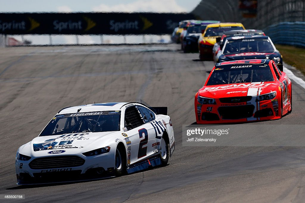 Brad Keselowski driver of the Miller Lite/Luke Bryan Ford leads a pack of cars during the NASCAR Sprint Cup Series CheezIt 355 at the Glen at Watkins...