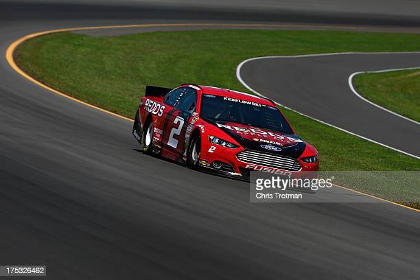 Brad Keselowski driver of the Redd's Apple Ale Ford drives during practice for the NASCAR Sprint Cup Series GoBowlingcom 400 at Pocono Raceway on...