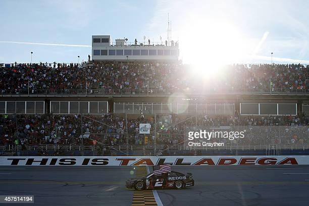 Brad Keselowski driver of the Redd's Wicked Apple Ale Ford celebrates after winning the NASCAR Sprint Cup Series GEICO 500 at Talladega Superspeedway...