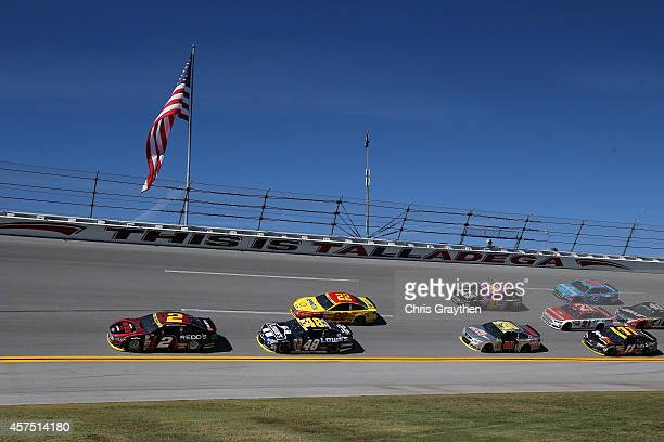 Brad Keselowski driver of the Redd's Wicked Apple Ale Ford leads the field during the NASCAR Sprint Cup Series GEICO 500 at Talladega Superspeedway...