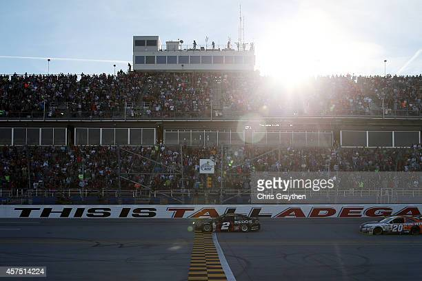 Brad Keselowski driver of the Redd's Wicked Apple Ale Ford takes the checkered flag to win the NASCAR Sprint Cup Series GEICO 500 at Talladega...
