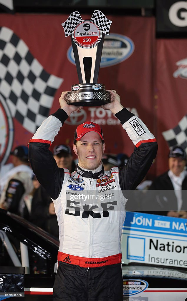 <a gi-track='captionPersonalityLinkClicked' href=/galleries/search?phrase=Brad+Keselowski&family=editorial&specificpeople=890258 ng-click='$event.stopPropagation()'>Brad Keselowski</a>, driver of the #22 SKF / Discount Tire Ford, celebrates in Victory Lane after winning the NASCAR Nationwide Series ToyotaCare 250 at Richmond International Raceway on April 26, 2013 in Richmond, Virginia.