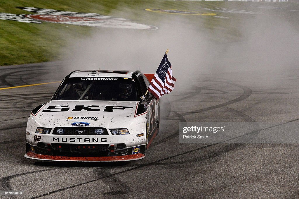 <a gi-track='captionPersonalityLinkClicked' href=/galleries/search?phrase=Brad+Keselowski&family=editorial&specificpeople=890258 ng-click='$event.stopPropagation()'>Brad Keselowski</a>, driver of the #22 SKF / Discount Tire Ford, celebrates with a burnout after winning the NASCAR Nationwide Series ToyotaCare 250 at Richmond International Raceway on April 26, 2013 in Richmond, Virginia.