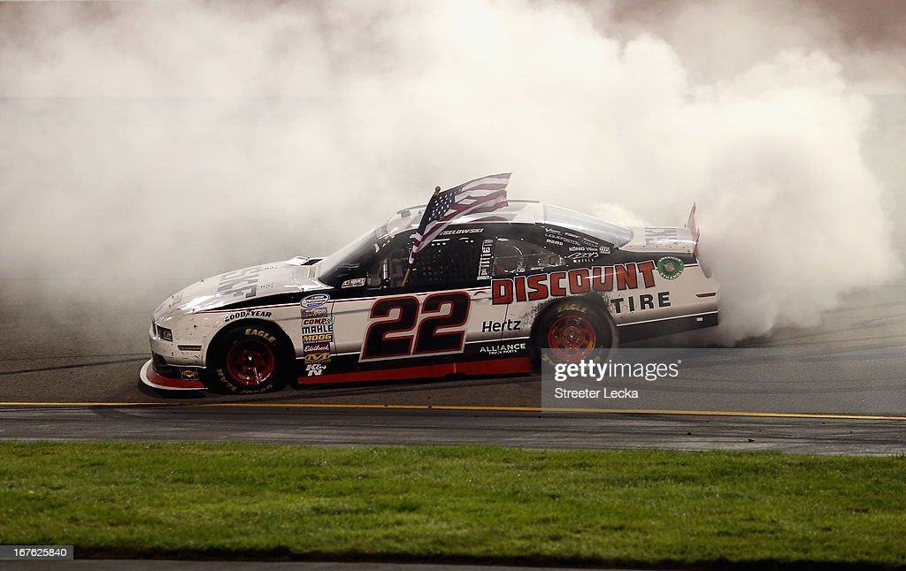 <a gi-track='captionPersonalityLinkClicked' href=/galleries/search?phrase=Brad+Keselowski&family=editorial&specificpeople=890258 ng-click='$event.stopPropagation()'>Brad Keselowski</a>, driver of the #22 SKF / Discount Tire Ford, performs a burn out to celebrate after winning the NASCAR Nationwide Series ToyotaCare 250 at Richmond International Raceway on April 26, 2013 in Richmond, Virginia.