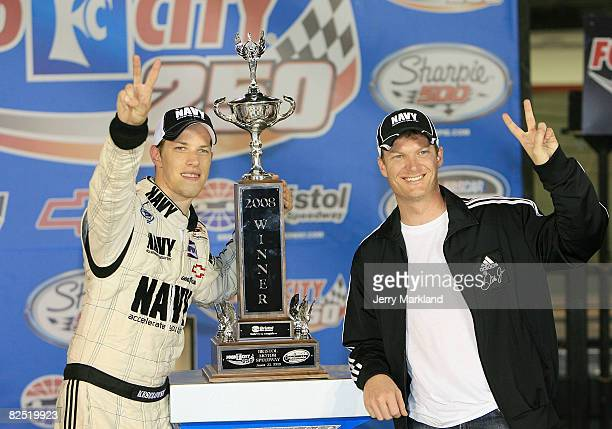 Brad Keselowski driver of the US Navy Chevrolet celebrates in victory Lane with car owner Dale Earnhardt Jr after winning the NASCAR Nationwide...