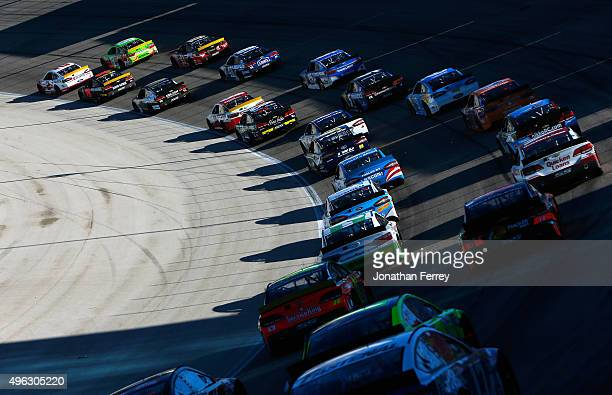Brad Keselowski driver of the Wurth Ford and Kyle Busch driver of the MM's Crispy Toyota lead the field during the NASCAR Sprint Cup Series AAA Texas...