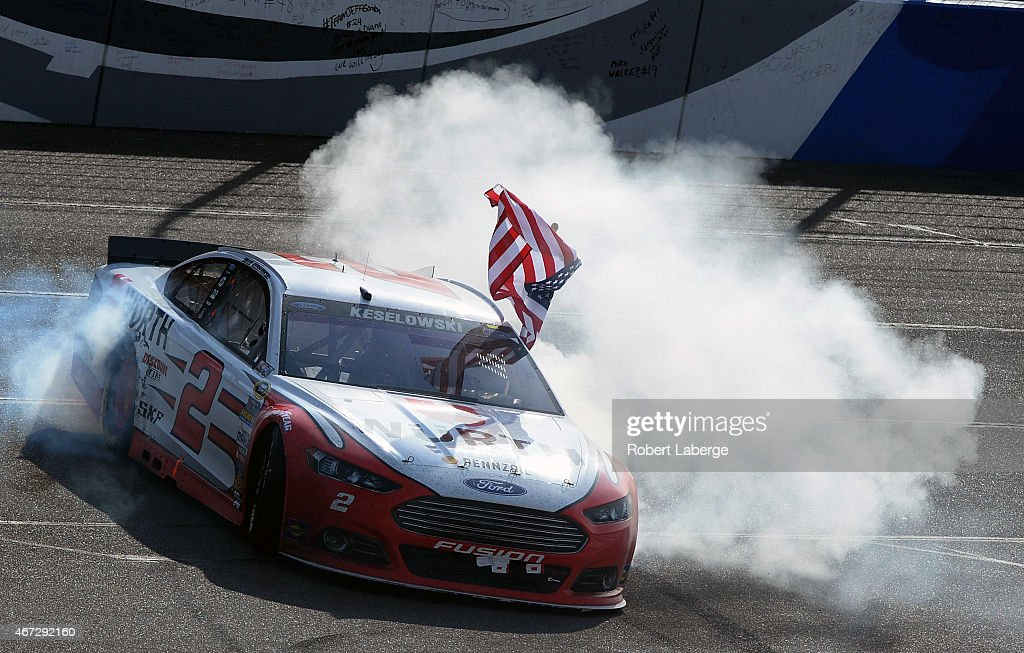 Brad Keselowski driver of the Wurth Ford celebrates after winning the NASCAR Sprint Cup Series Auto Club 400 at Auto Club Speedway on March 22 2015...