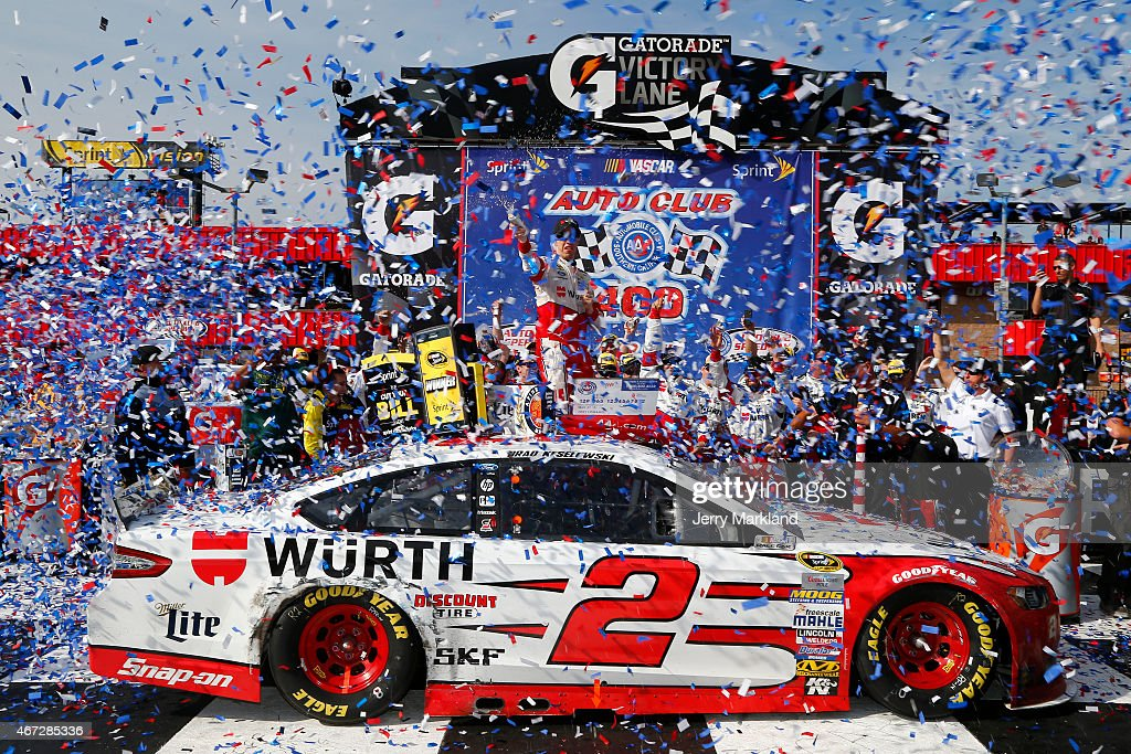 Brad Keselowski driver of the Wurth Ford celebrates in Victory Lane after winning the NASCAR Sprint Cup Series Auto Club 400 at Auto Club Speedway on...