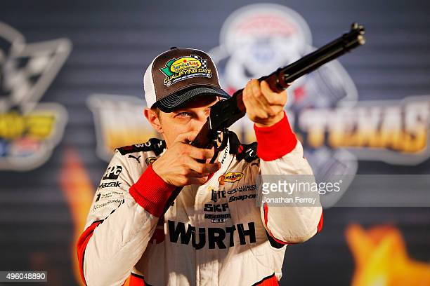 Brad Keselowski driver of the Wurth Ford celebrates with the track Rifle Pole Award after Service King qualifying for the NASCAR Sprint Cup Series...