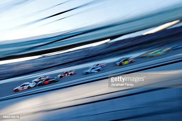 Brad Keselowski driver of the Wurth Ford leads a pack of cars during the NASCAR Sprint Cup Series AAA Texas 500 at Texas Motor Speedway on November 8...