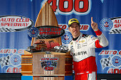 Brad Keselowski driver of the Wurth Ford poses in Victory Lane afer winning the NASCAR Sprint Cup Series Auto Club 400 at Auto Club Speedway on March...