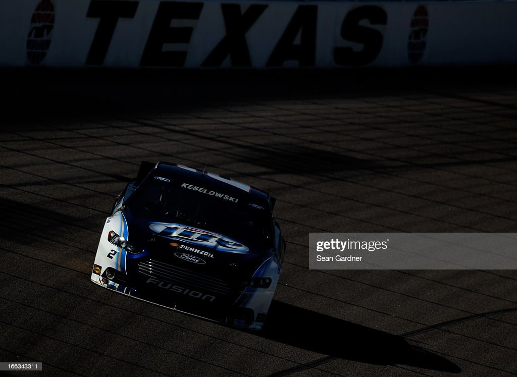 <a gi-track='captionPersonalityLinkClicked' href=/galleries/search?phrase=Brad+Keselowski&family=editorial&specificpeople=890258 ng-click='$event.stopPropagation()'>Brad Keselowski</a> drives of the #2 Miller Lite Ford during NASCAR Sprint Cup Series Gen-6 Testing at Texas Motor Speedway on April 11, 2013 in Fort Worth, Texas.