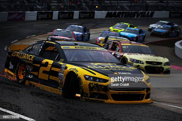 Brad Keselowski drives the Alliance Truck Parts Ford after being involved in an ontrack incident during the NASCAR Sprint Cup Series Goody's Headache...