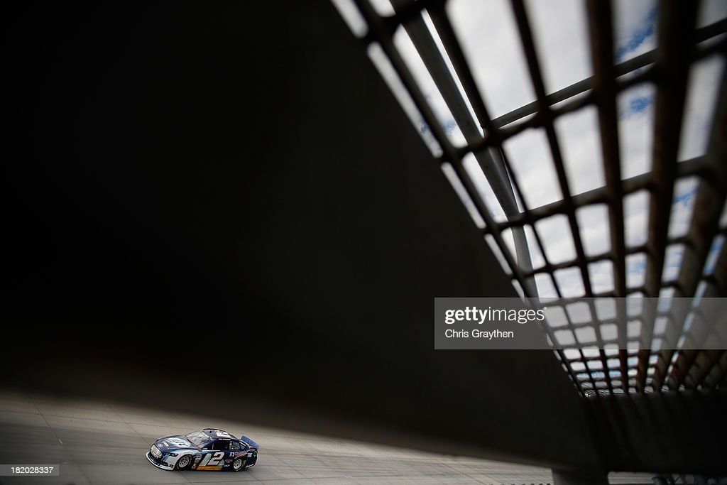 <a gi-track='captionPersonalityLinkClicked' href=/galleries/search?phrase=Brad+Keselowski&family=editorial&specificpeople=890258 ng-click='$event.stopPropagation()'>Brad Keselowski</a> drives the #2 Miller Lite Ford during qualifying for the NASCAR Sprint Cup Series AAA 400 at Dover International Speedway on September 27, 2013 in Dover, Delaware.