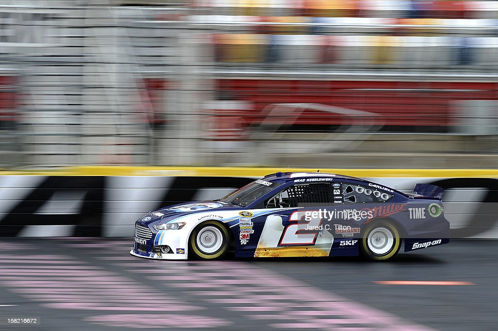 <a gi-track='captionPersonalityLinkClicked' href=/galleries/search?phrase=Brad+Keselowski&family=editorial&specificpeople=890258 ng-click='$event.stopPropagation()'>Brad Keselowski</a> drives the #2 Miller Lite Ford during testing at Charlotte Motor Speedway on December 11, 2012 in Concord, North Carolina.